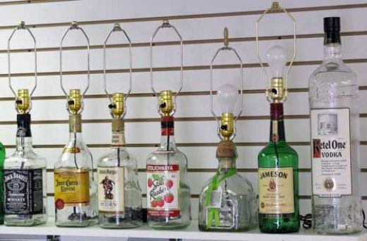 Handcrafted liquor bottle lamps Even if you dont like the liquor bottle look these bottles could be painted wrapped in ropeyarn modgepodged with paper or fabric seashells...