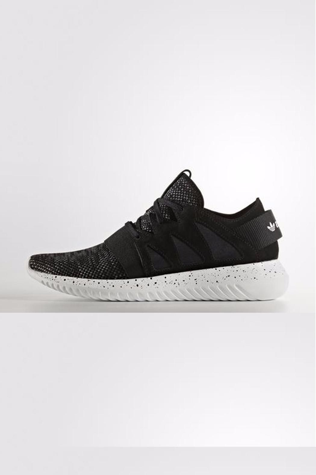 sale retailer 8b4c1 91552 TUBULAR SHOES WITH A MÉLANGE UPPER AND A SPECKLED OUTSOLE. The Tubular  streetwear series evolved