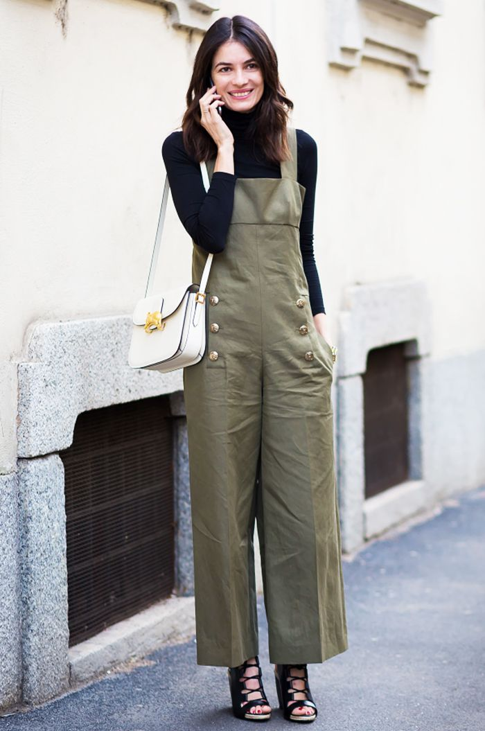 bb463ac13bc Leila Yavari in a khaki Sonia Rykiel jumpsuit paired with a Jil Sander  turtleneck and Pierre Hardy shoes; white Valentino bag.