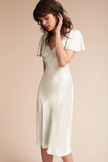 ffa42bbb66b1 Dress - Simple ivory coloured satin mid-length dresses would put the focus  on my beautiful bridesmaids rather than their beautiful dresses.
