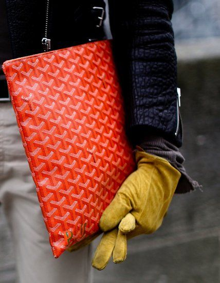 Behold, the Best Accessories From the Paris Fashion Week Style Set: This minibag spoke volumes thanks to the cool colorblocked colors.: Nothing says pure luxury like a statement red Goyard portfolio.