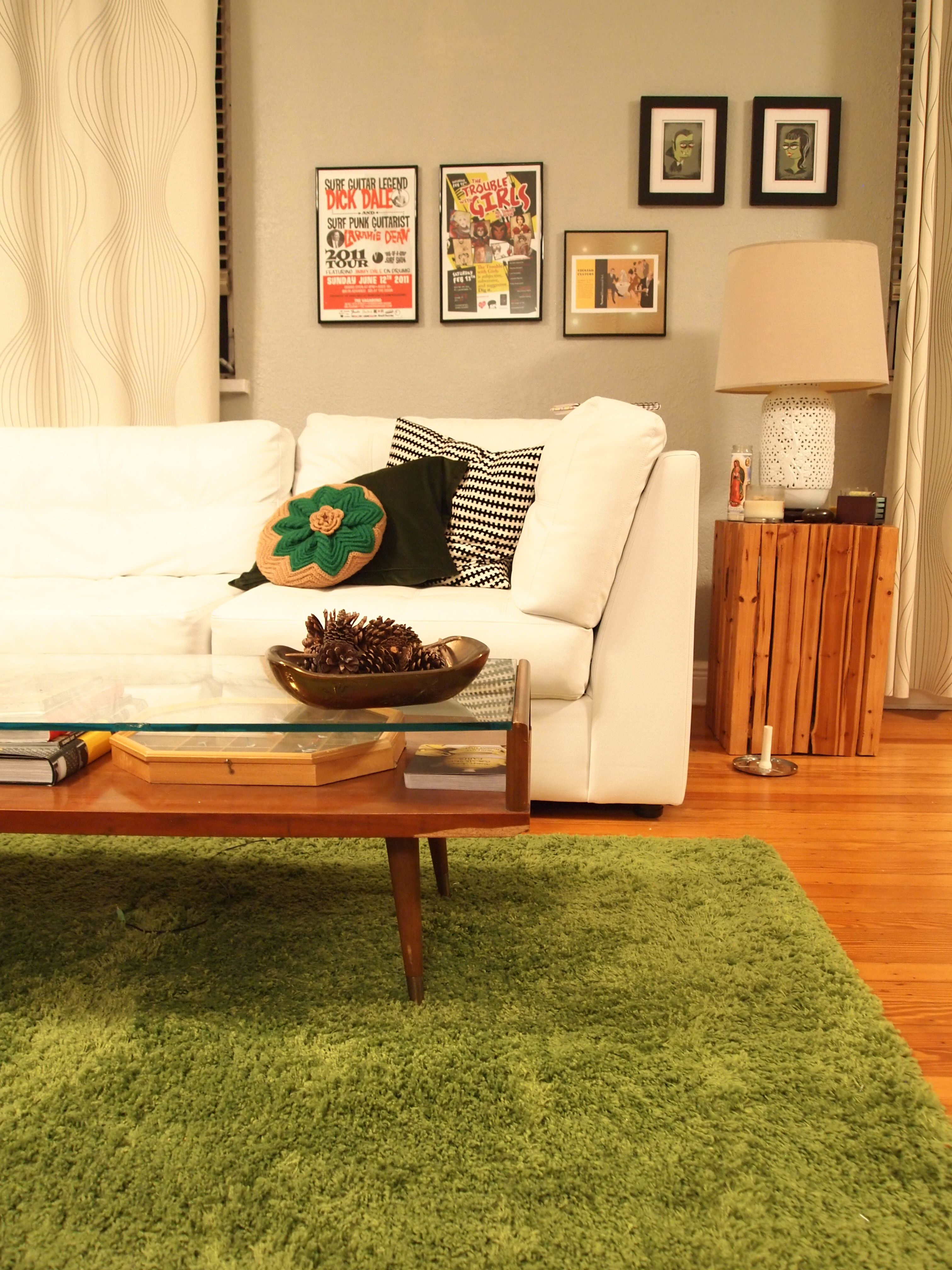 white couch, gray walls, honey floors, with black and green accents ...