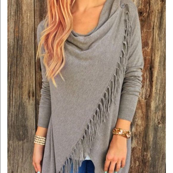 Grey tassel hem asymmetrical shirt size M NEW Purchased online and it's too big for me  My loss is someone else's gain! Brand new! Does not have tags but comes in original packaging. Tops Tees - Long Sleeve