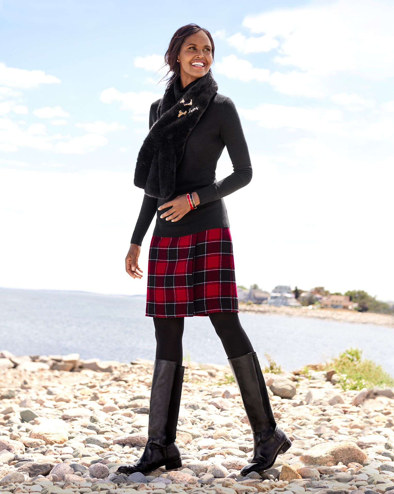 A winter plaid a-line skirt with boots and sweaters is an ...