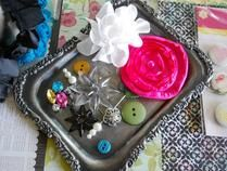 embellishments, love the pink flower and the hat pin