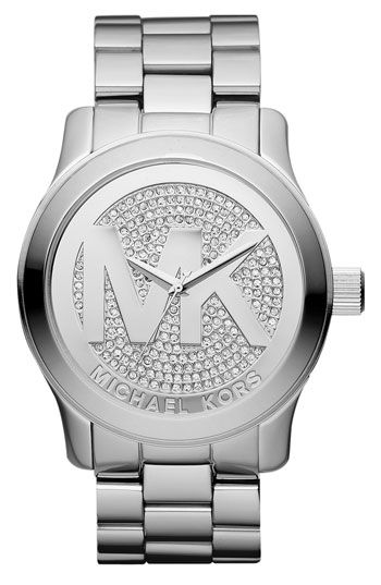 671eeb0dcc74 Michael Kors  Bright crystals light up the logo-centered dial of a round  watch forged from brilliant stainless steel.Approx. case diameter  45mm.