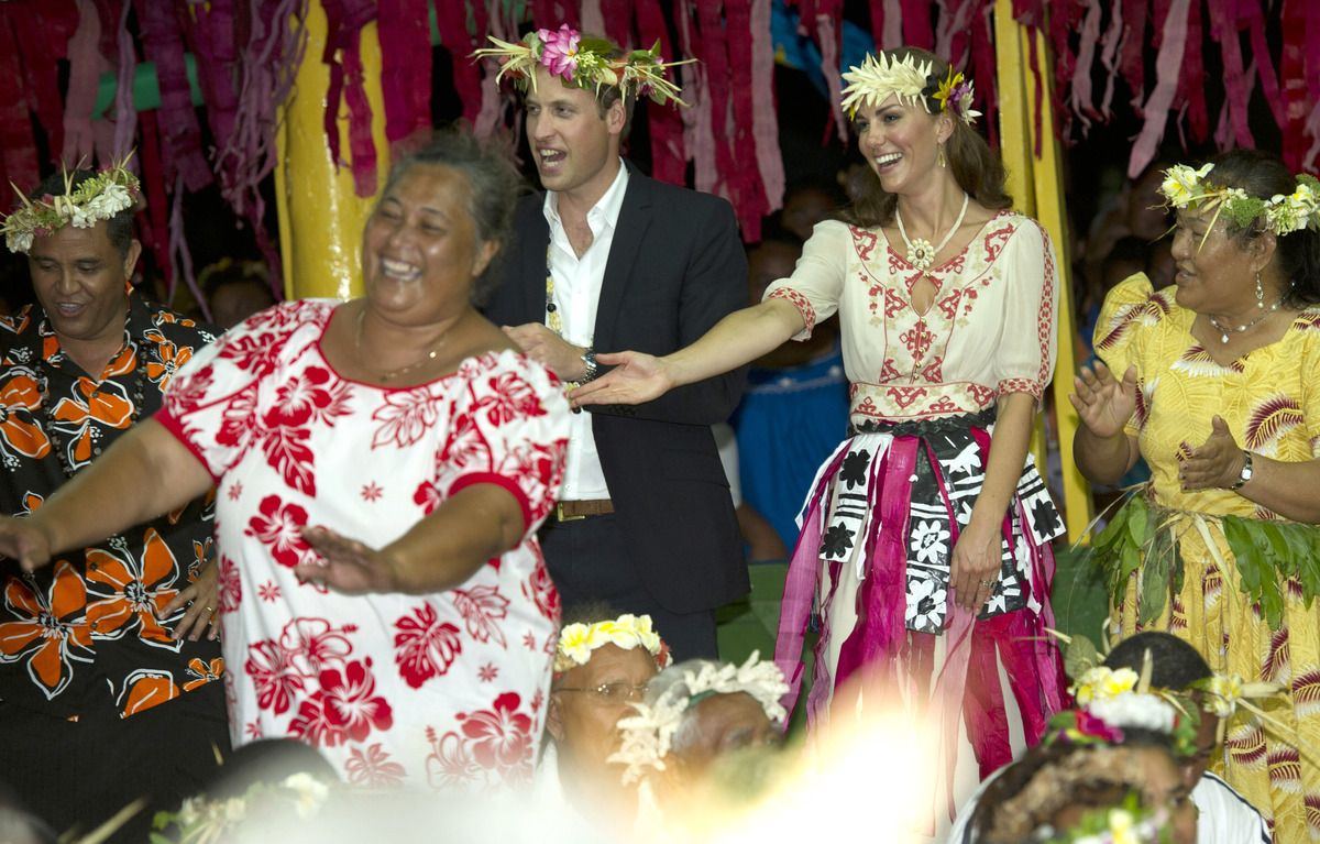 Prince William, Duke of Cambridge and Catherine, Duchess of Cambridge dance with the ladies at the Vaiku Falekaupule for an entertainment programme on September 18, 2012 in Tuvalu. Prince William, Duke of Cambridge and Catherine, Duchess of Cambridge are on a Diamond Jubilee tour representing the Queen taking in Singapore, Malaysia, the Solomon Islands and Tuvalu