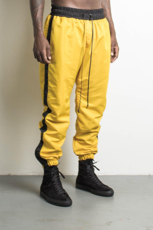 Parachute Track Pants In Yellow Black By Daniel Patrick Lee
