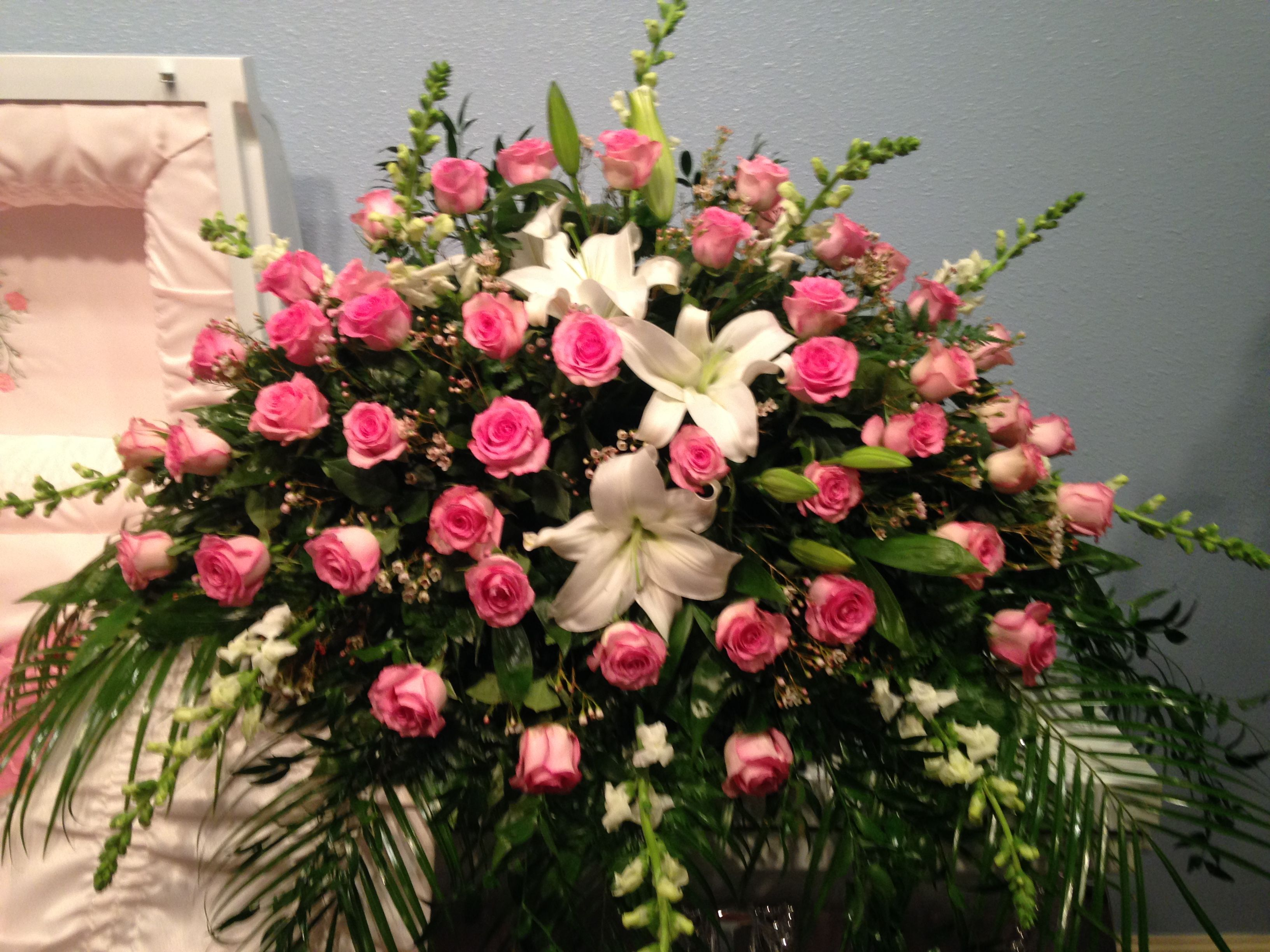 Fresh Casket Spray Using White Lilies White Snapdragons Pink Roses
