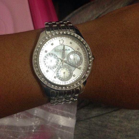 BCBG silver watch BCB Girls silver watch fairly new. Missing one little diamond on the top BCBGirls Jewelry