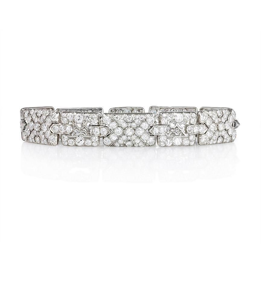 An Art Deco Diamond Bracelet With Alternating Open And Pave Rectangular Links In Platinum