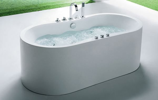 freestanding whirlpool tub offers an ample deck space for versatile