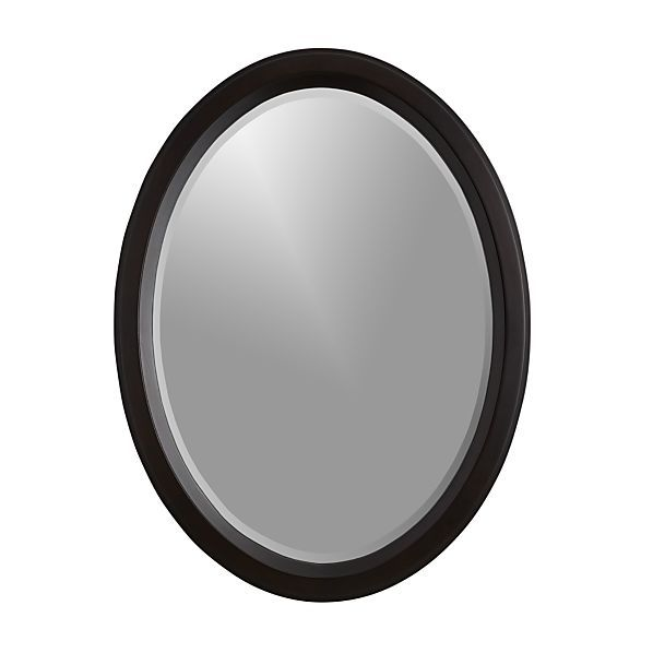 Forming A Perfect Oval This Classic Shape Frames Simple Beveled Mirror In Dark