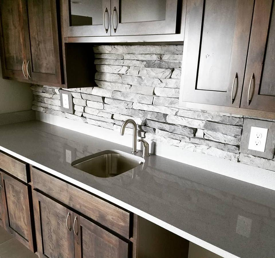 the contrast between the rough hewn stacked stone backsplash and the rh pinterest com