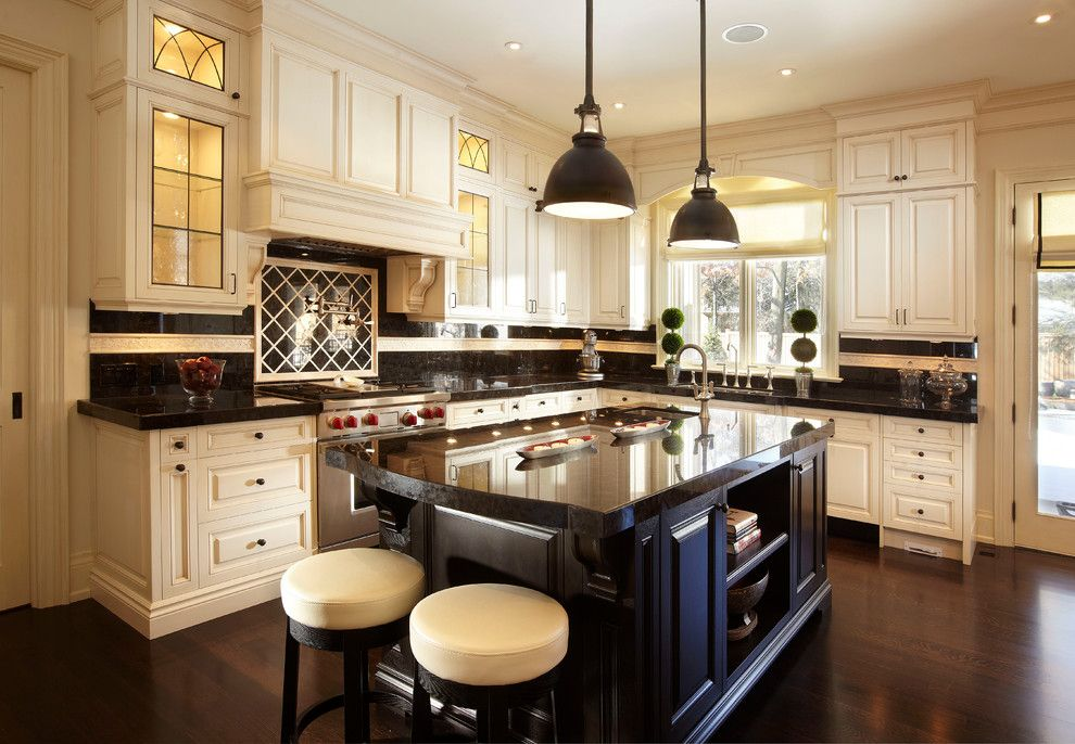 The Lux Getaway   Traditional   Kitchen   Toronto   Parkyn Design Dark  Counters Wood Floor Cream Cabinets