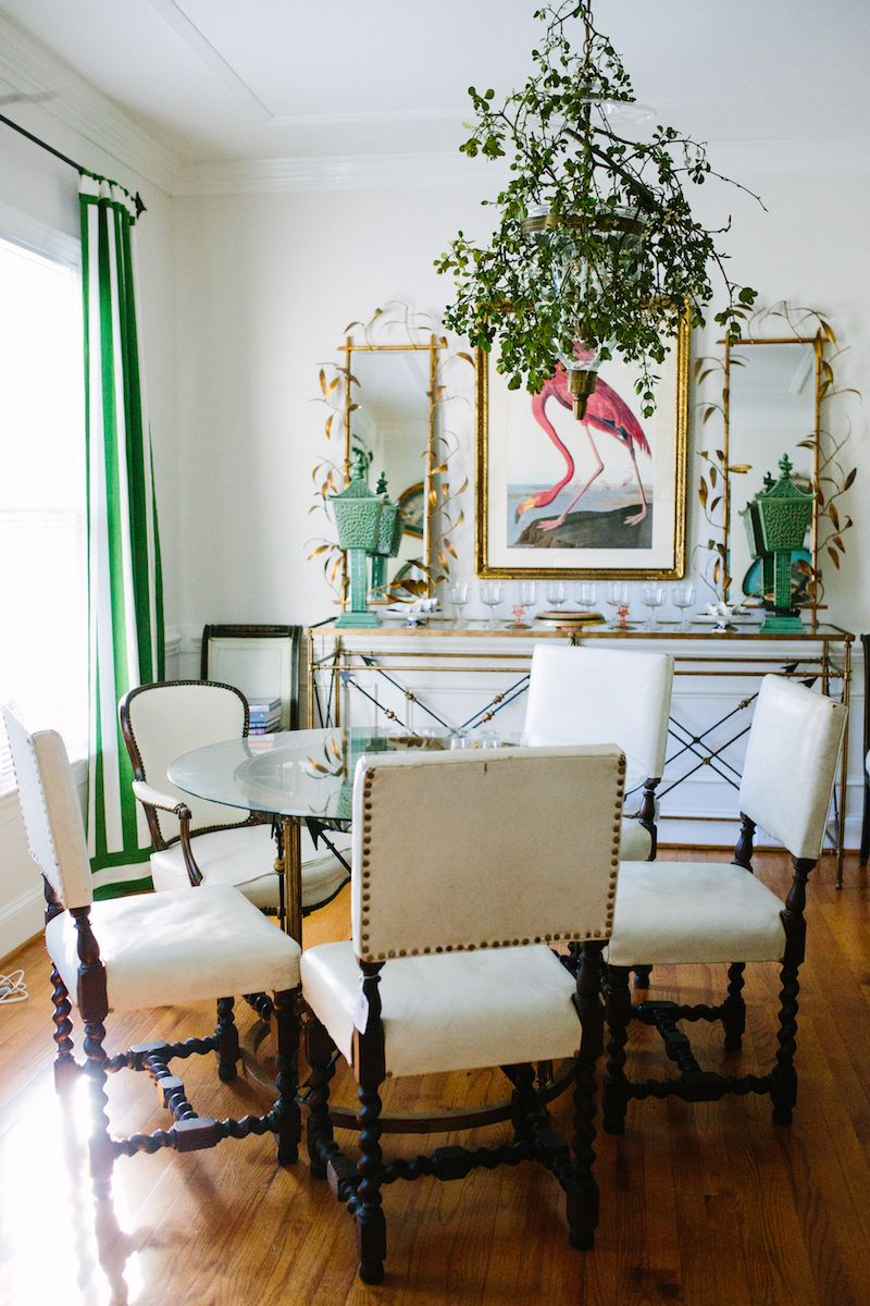 Vibrant Green And White Cabana Stripe Curtains A Vintage Flamingo Print Add Some Tropical Flair To This Traditional Dining Room