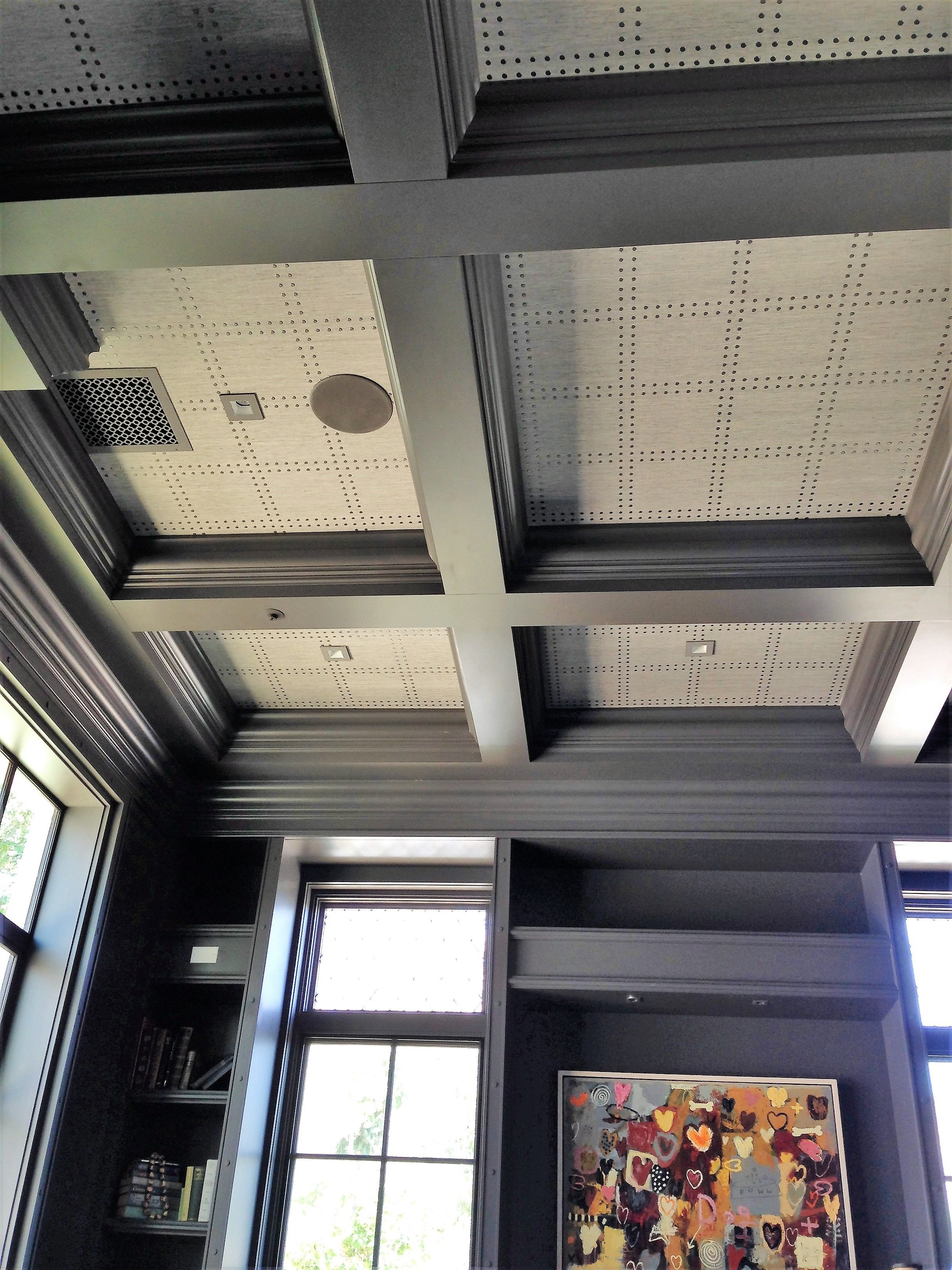 Phillip Jeffries rivets installed on a coffered ceiling Paradise