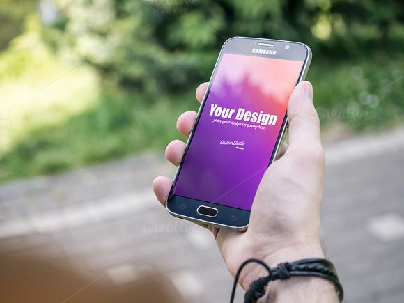 Smartphone PSD Mockup in Man's Hand by CustomStudio on @creativemarket