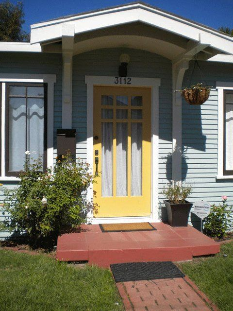 Light Blue House Yellow Door In 2020 House Paint Exterior Light Blue Houses Exterior House Colors