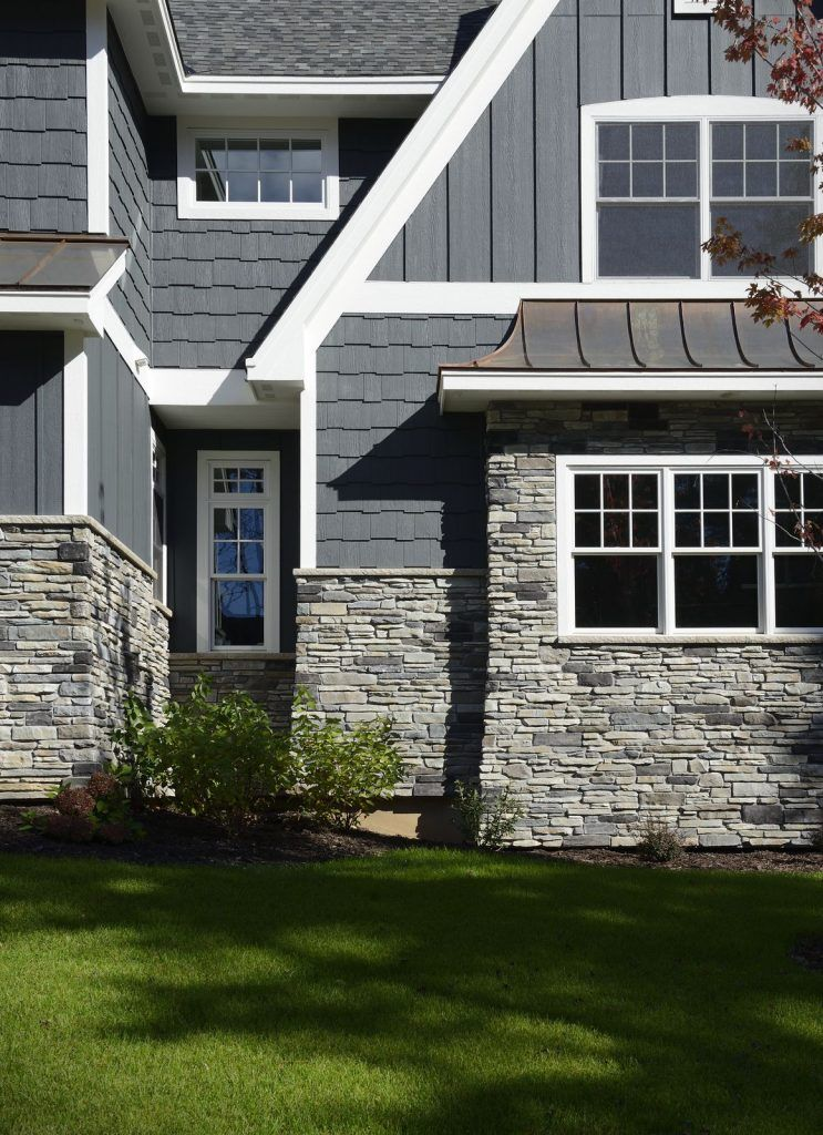 Cultured Stone Textured Watertable Sills Gray Stone Exterior