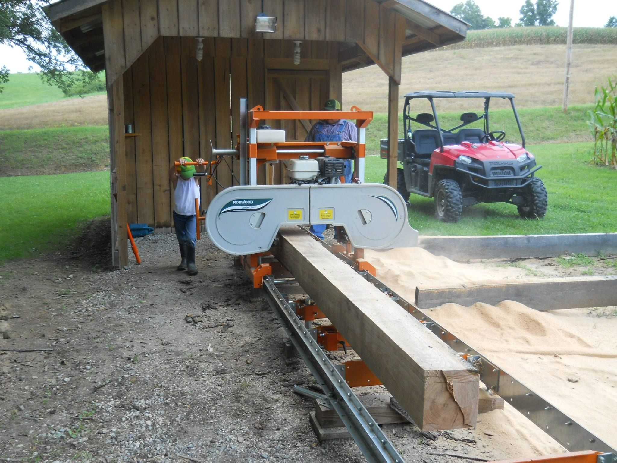 charlie brunner s grandson helps out sawmills logs to lumber