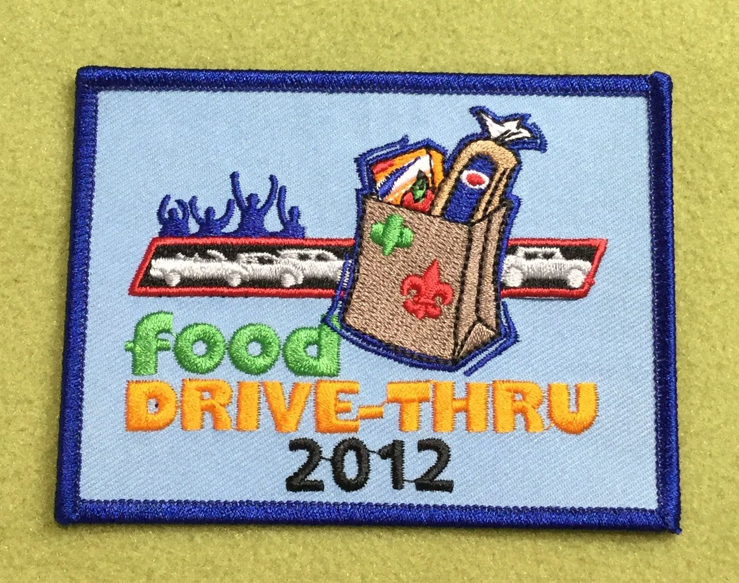 Girl Scout 100th anniversary year patch. Food drive-thru 2012. eBay find.