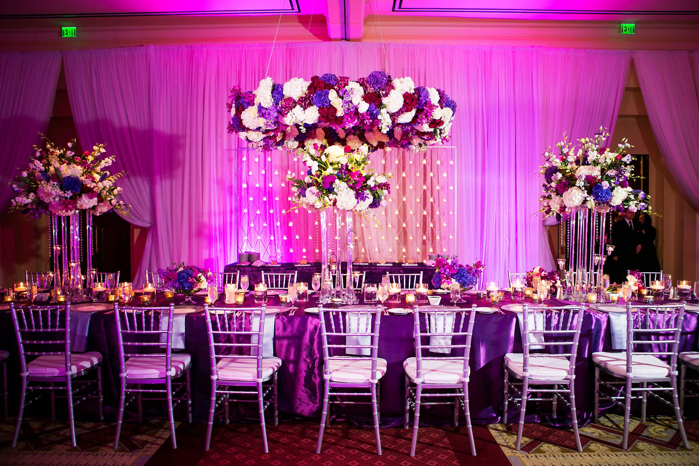 Festive indoor reception with tall centerpieces | Weddings & Events ...