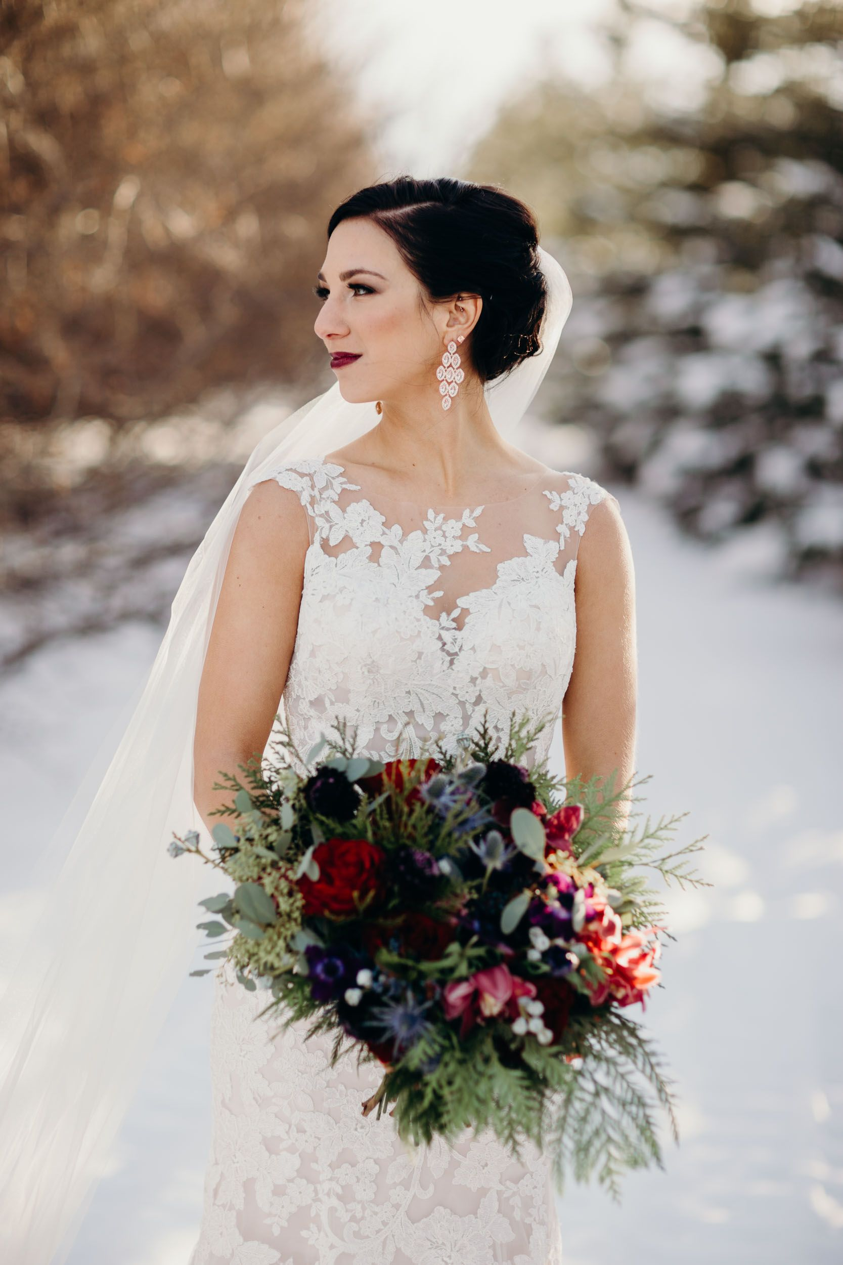Red deer wedding photographer winter wedding bride groom snow