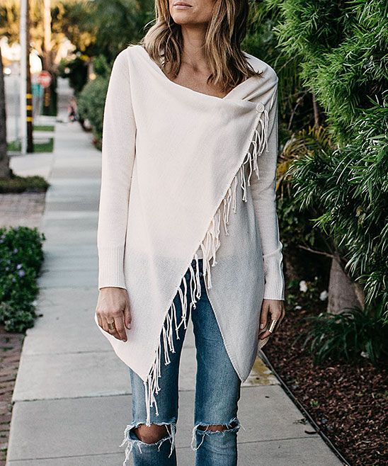 A cozy wrap style and fringe detail exude effortless charm and offer all day comfort with a soft cotton-linen blend.Size S: 26'' long from high point of shoulder to hem50% linen / 50% cottonHand wash; dry flatImported