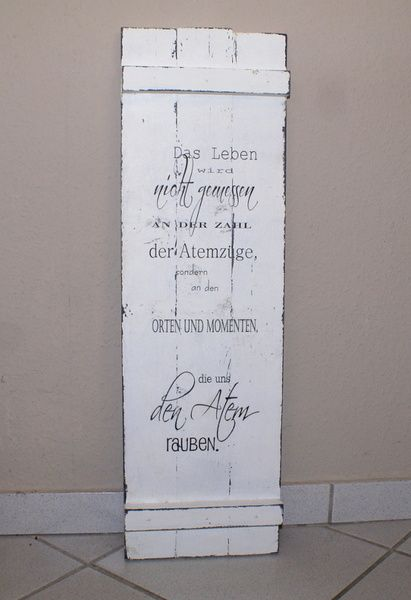 Photo of Rustic wooden sign made of panels in shabby chic style with a saying about …