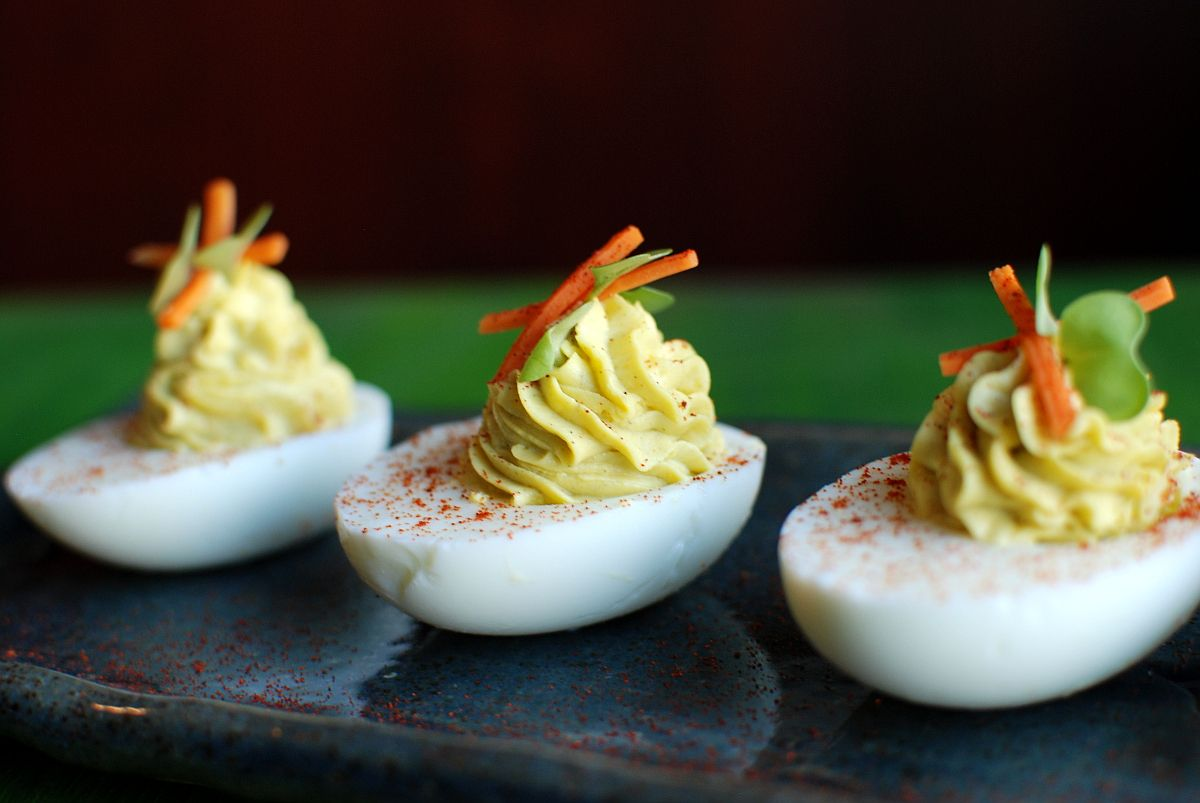"""Deviled eggs are a holiday party staple. This year, if you feel like waking up Aunt Linda, you can sneak some wasabi into the mix. I mean, aren't deviled eggs supposed to be devilish in some way? Wikipedia says that the term """"deviled"""" in relation to food means something spicy or zesty, but most are just mayo bombs. So let's bring the devil back into the picture!"""