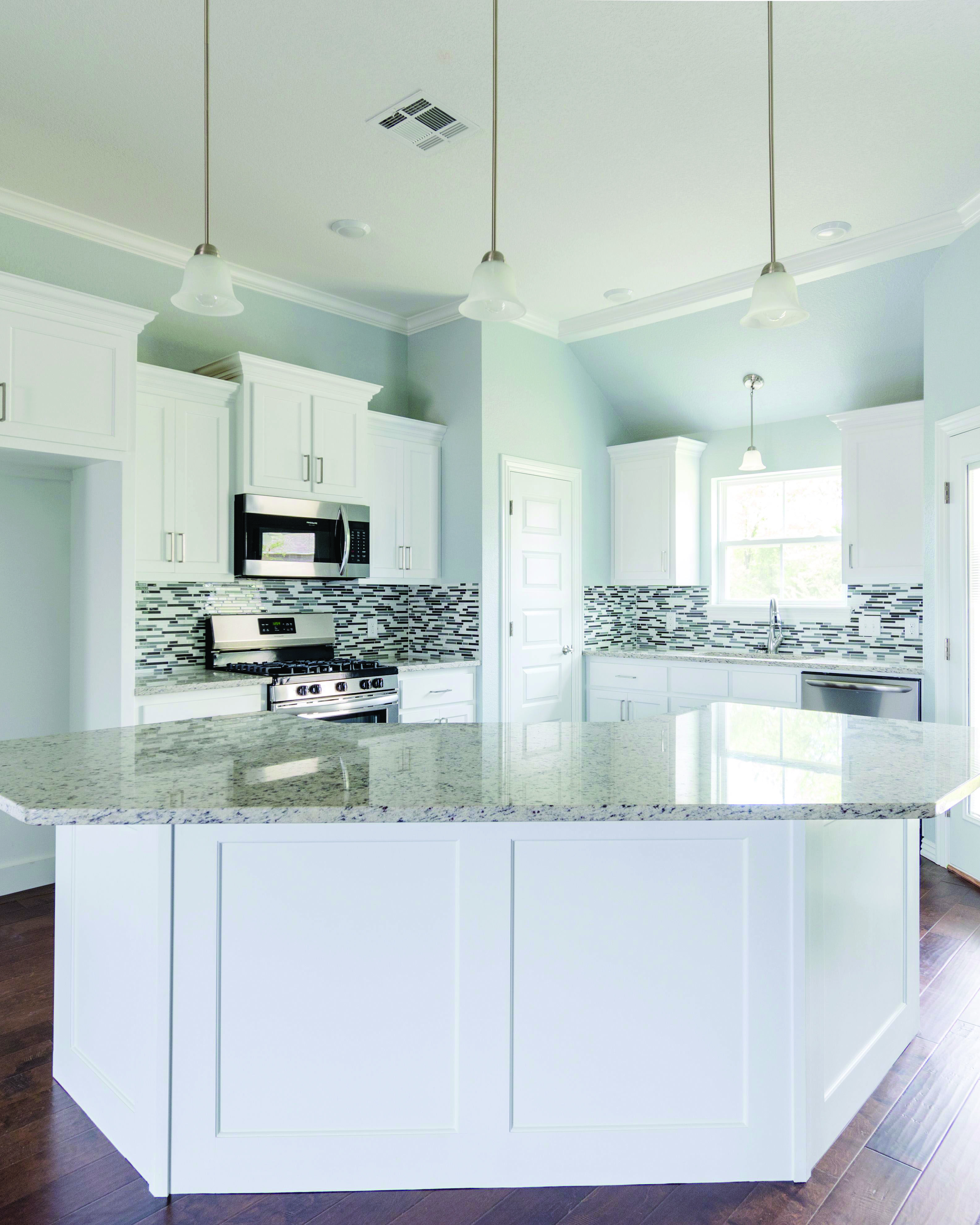 White Kitchen Cabinets And Light Blue Walls