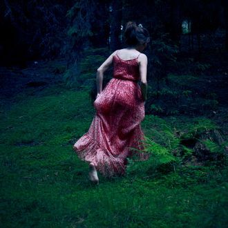 Young woman dancing in the forest. It works well together with part 1 and 2 as triptych