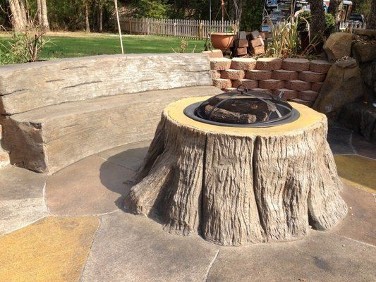 Stamped Concrete Fire Pit With A Concrete Bench Made To Like Wood Concrete Fire Pits Outdoor Fire Pit Table Fire Pit Patio