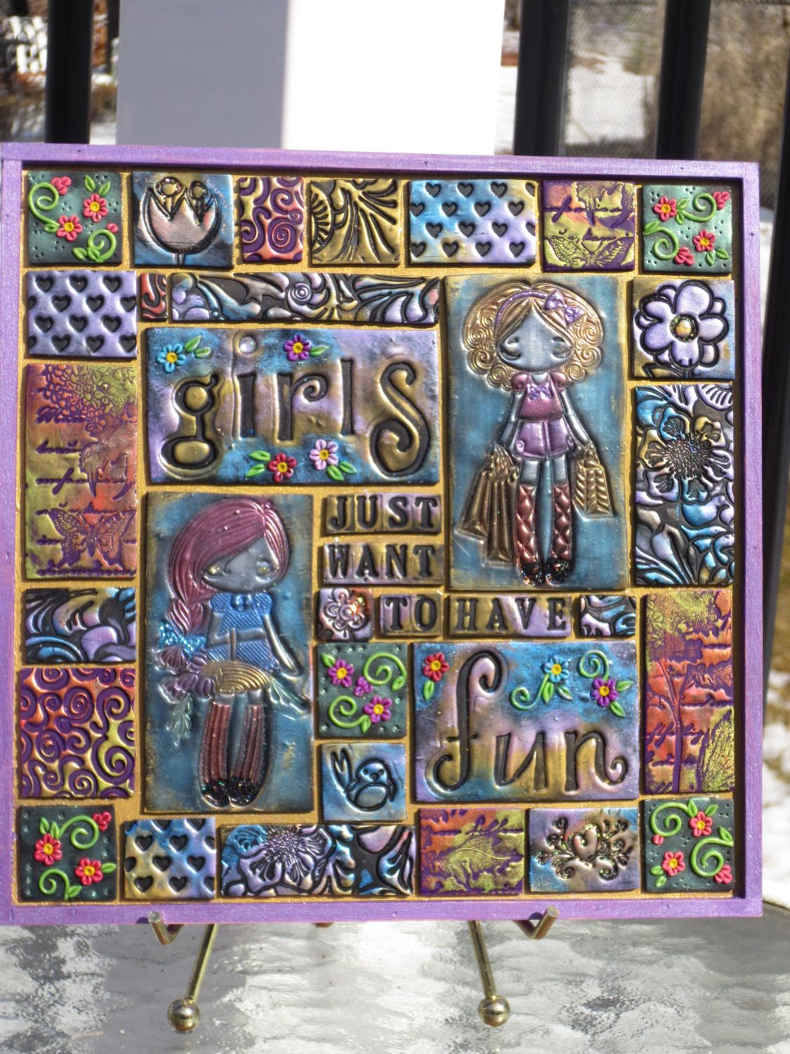 Polymer Clay Tiles With Stamped Images And Lique Flowers Have Been Accented Glitter Colored Mica Powders