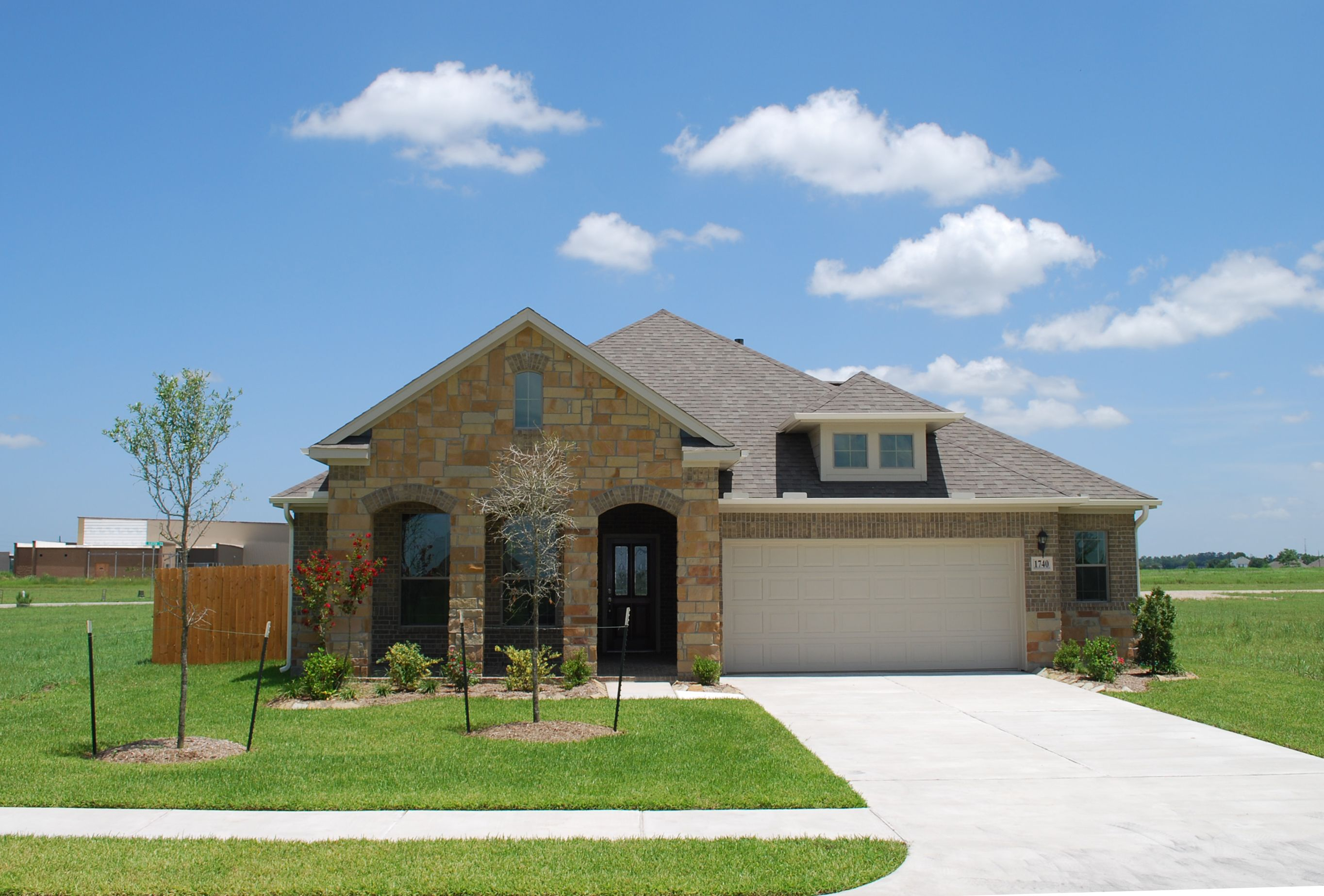 Celeste Exterior With A Light Stone Finish And Arches