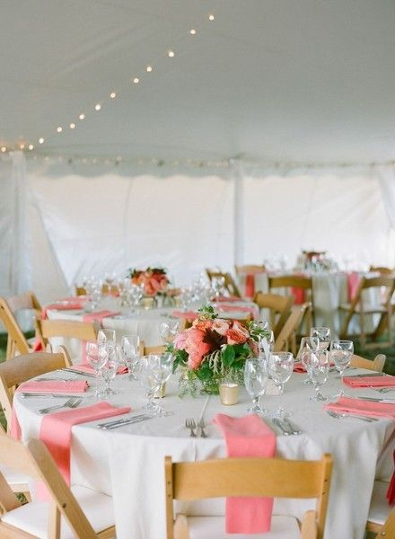 Summer wedding reception decor idea - white tent with round tables, white table linens, pink napkins and floral centerpieces {Stacey Hedman Photography}
