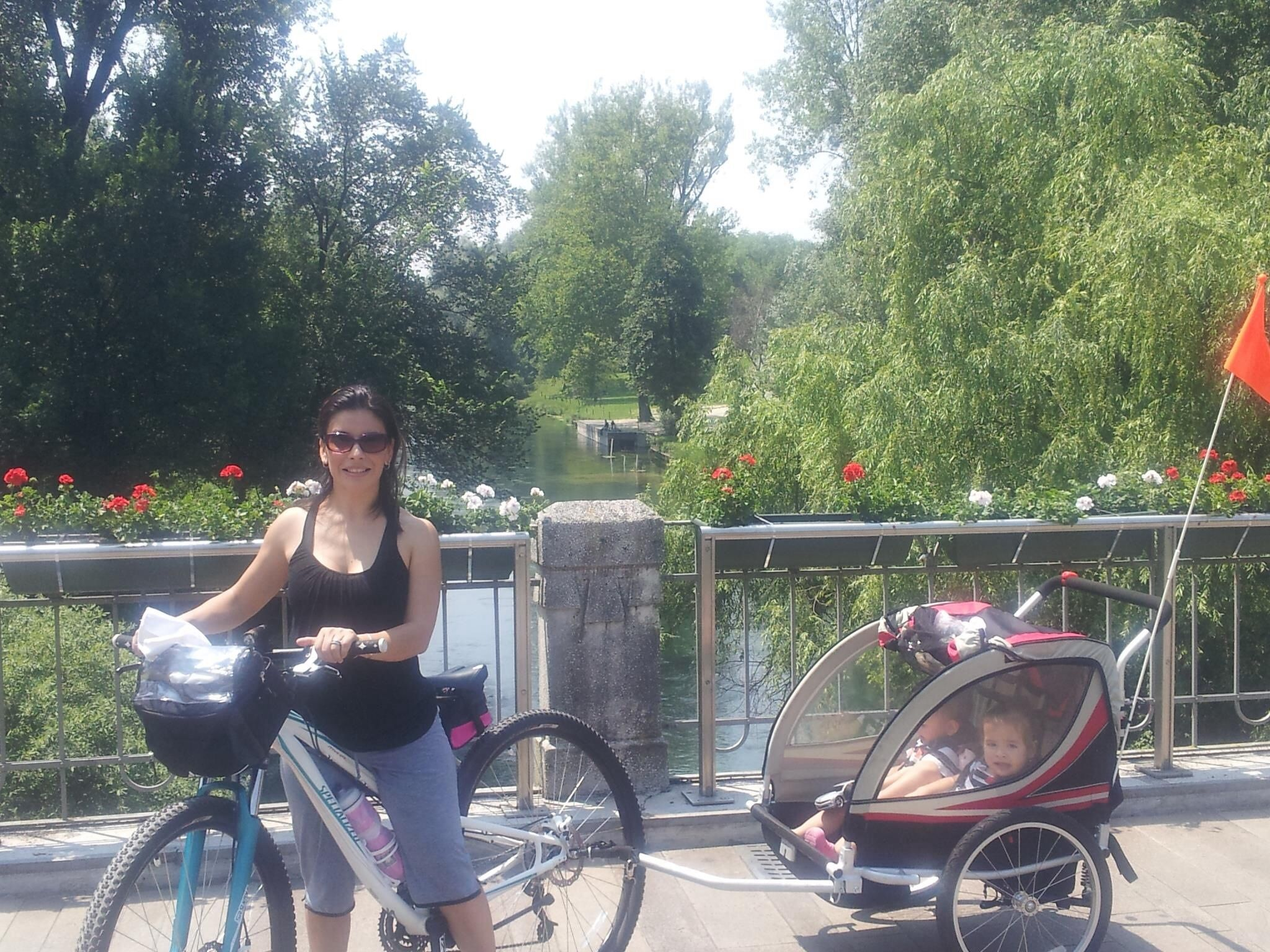 Pulling my twins with my mountain bike through Pordenone Italy. What better way to stay in somewhat shape than to lug 40 plus lbs of babies :-) #twins # Zulma #Italy