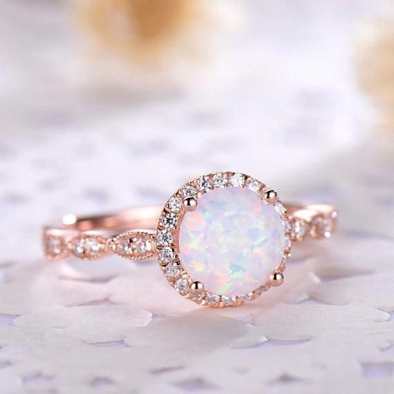 9a256888d8c3e This is an opal engagement ring rose gold. The stones are Opal and ...