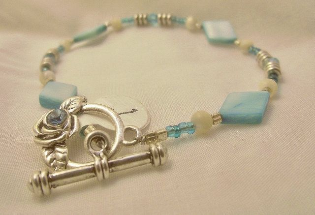This is absolutely beautiful.  Can anyone say Mother's Day?  Bracelet light blue mother of pearl. $7.00, via Etsy.