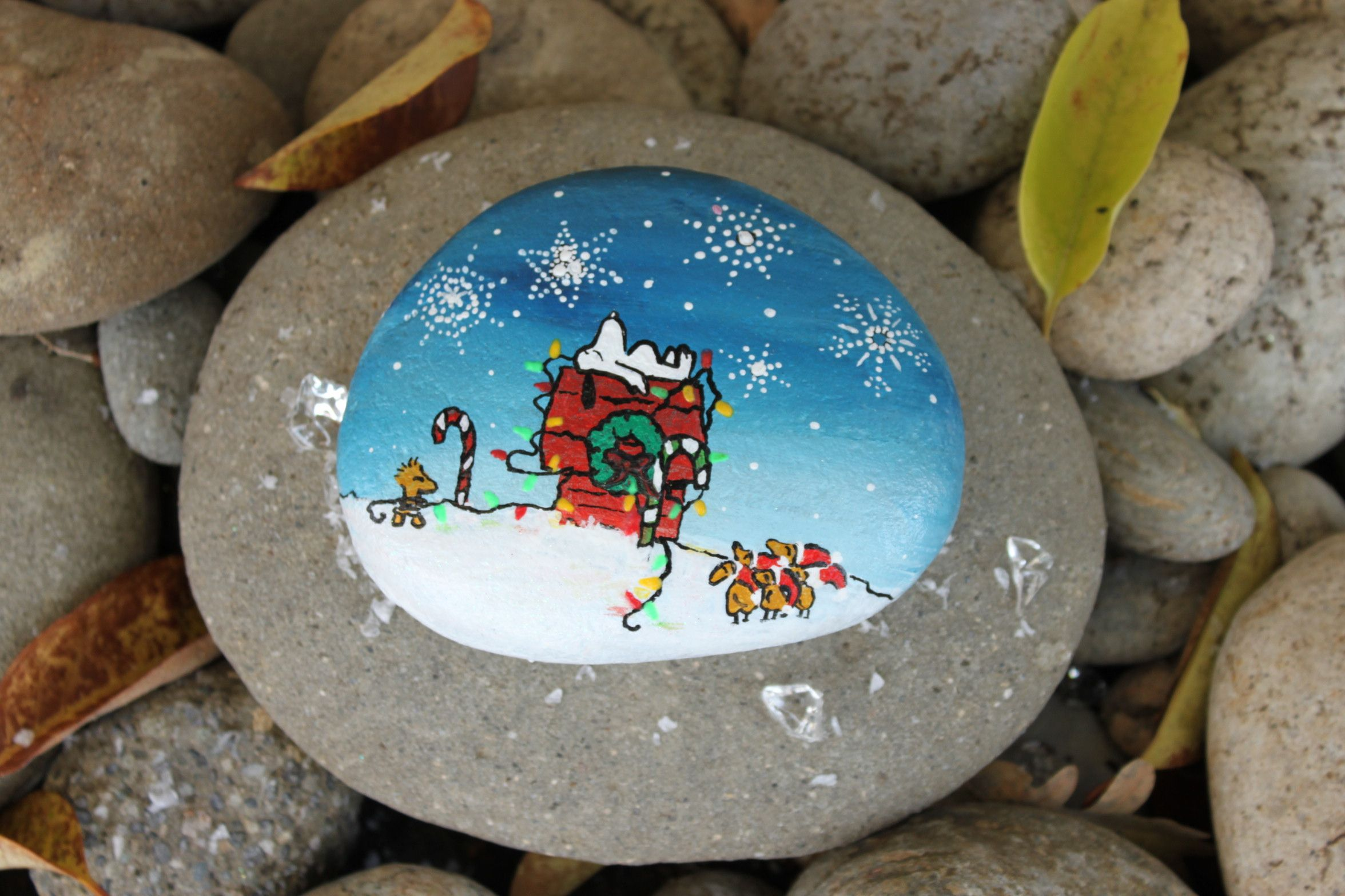 Snoopy sleeping Christmas scene - hand painted rock by Jessica Burcell