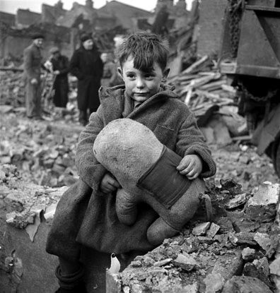 abandoned boy holding a stuffed toy - such a moving picture!
