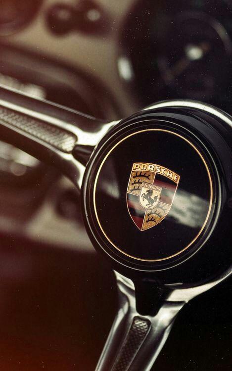 Porsche logo on steering