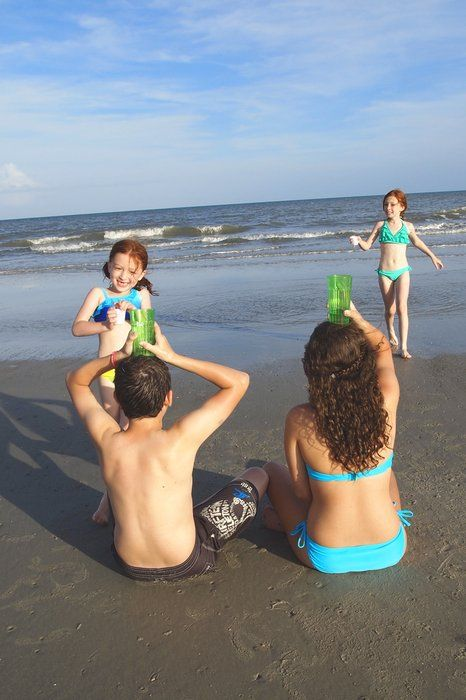 water relay: fun kids' beach games you haven't played yet - mom