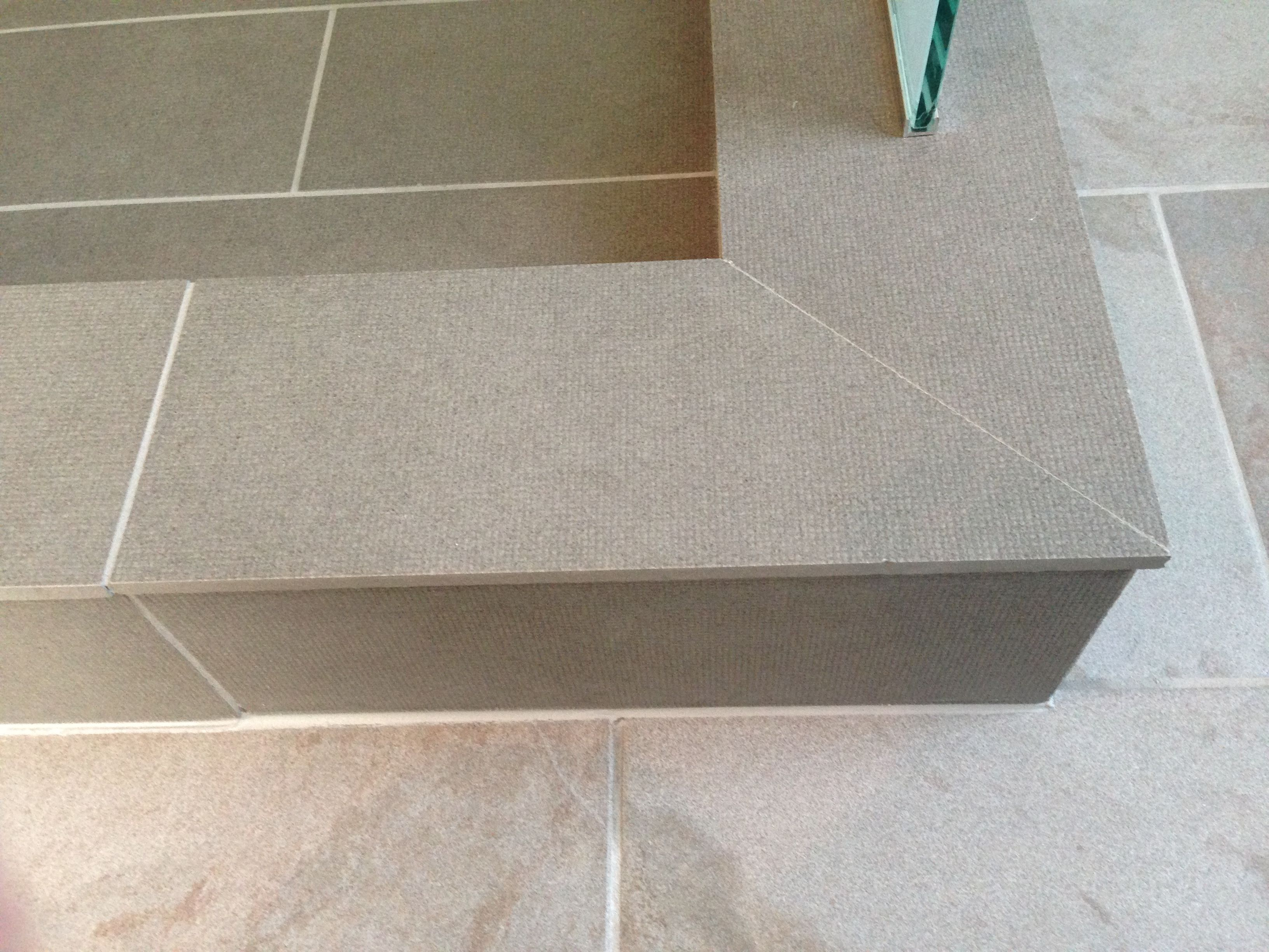 Mitre of outside corner of shower curb | Tile edge, Shower curb