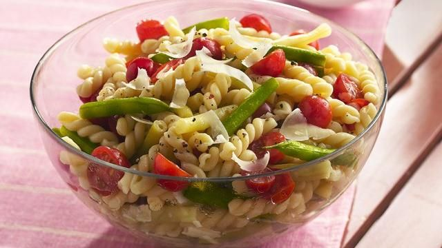Fresh beans and tomatoes add color and crunch to a simple pasta salad seasoned with tarragon vinegar.