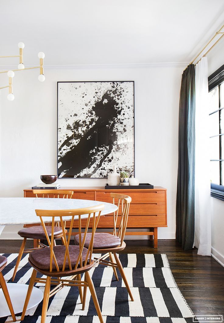 Midcentury Modern Dining Room With A Buffet With Large Art And A Stripped Rug Mid Century Dining Room Modern Dining Room Modern Dining