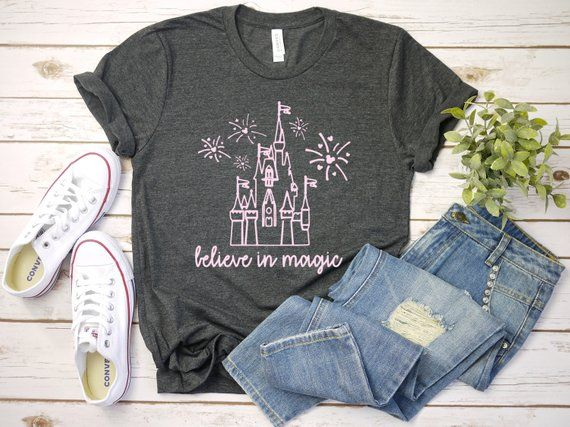 203c2124 Disney Believe in Magic Tee - Bella and Canvas short sleeve t-shirt The  listing photo is shown with a dark grey heather tee and light pink vinyl.