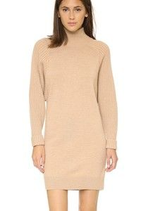 Oversized, ribbed long sleeves add to the slouchy look of this mock-neck Club Monaco sweater dress. Unlined. Fabric: Mixed knit. Shell: 100% wool. Trim: 98% wool/1% elastane/1% other fiber. Hand wash or dry clean. Imported, China. Measurements Length: 32.75in / 83cm, from shoulder Measurements from size S