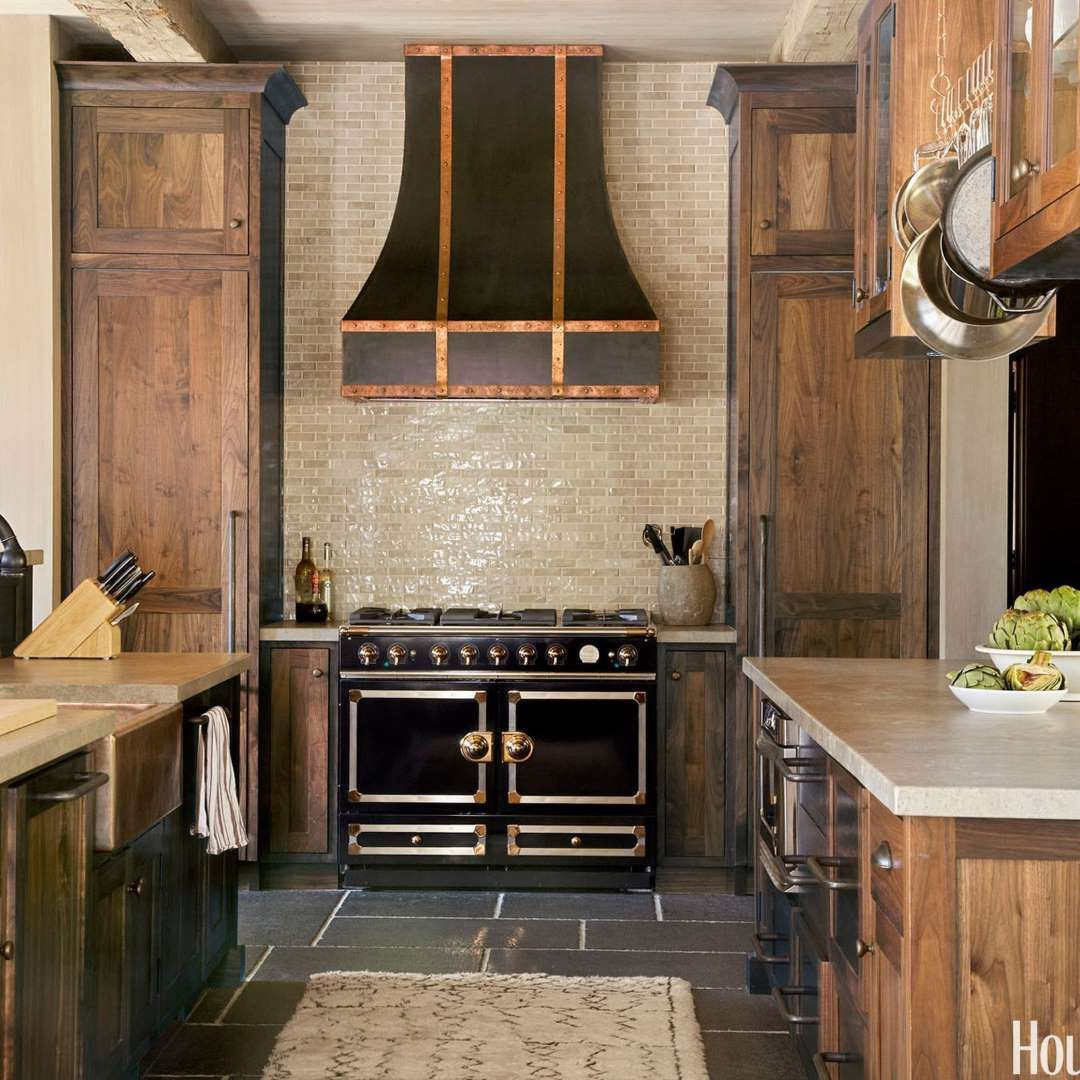 A La Cornue Stove And Custom Hood With Copper Accents Command Attention In  The Kitchen Of